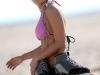 Francia Raisa in a bikini roller skating