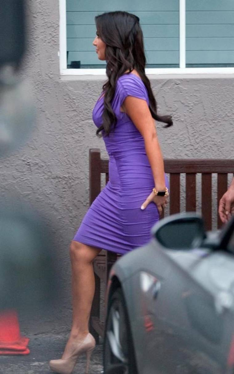 Kim Kardashian in purple dress out in Miami