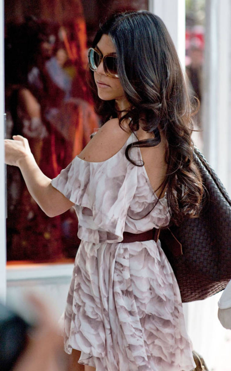 Kourtney and Khloe Kardashianat Dash Boutique in Miami
