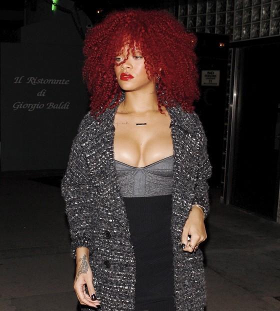 Rihanna shows legs and great cleavage at Giorgio Baldi Ristorante in Santa Monica