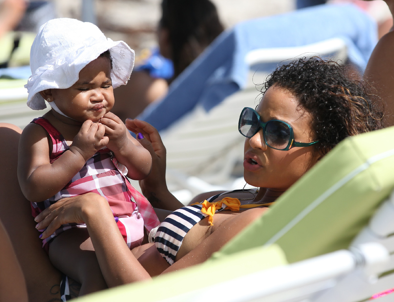 Christina Milian 2011 : Christina Milian and daughter on the beach in Miami