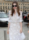 Anne Hathaway in white dress attending to a Givenchy private show in Paris