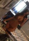 Kim Kardashian taking pics of herself in a bikini