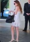 Lindsay Lohan shows her legs in short dress in Santa Monica
