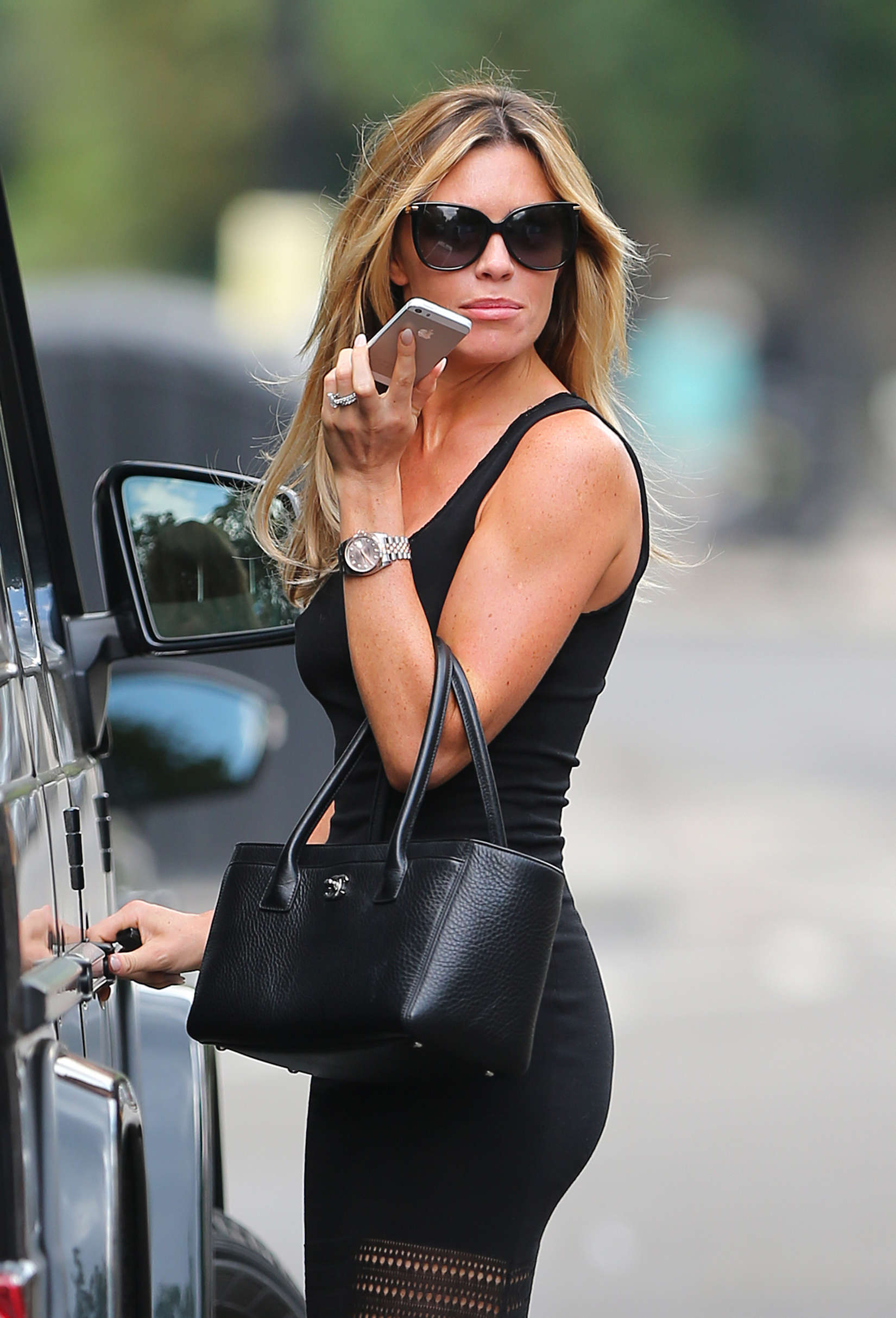 abbey clancy hot in black dres in north london