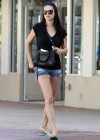Adriana Lima shows her legs in short shorts out and about in Miami 1/5/13