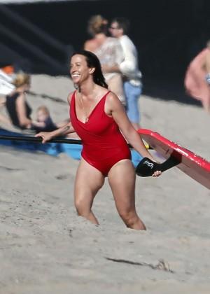 Alanis Morissette paddleboarding in red swimsuit -03
