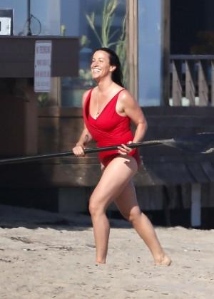 Alanis Morissette paddleboarding in red swimsuit -05