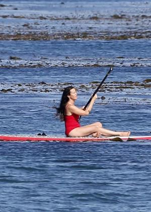 Alanis Morissette paddleboarding in red swimsuit -08