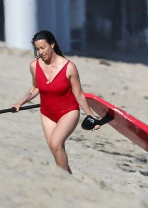 Alanis Morissette paddleboarding in red swimsuit -09