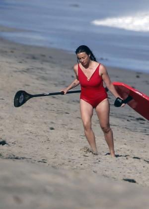 Alanis Morissette paddleboarding in red swimsuit -13