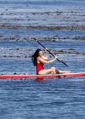 Alanis Morissette paddleboarding in red swimsuit -14
