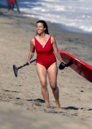 Alanis Morissette paddleboarding in red swimsuit -15