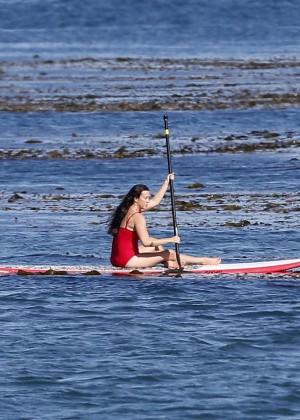 Alanis Morissette paddleboarding in red swimsuit -16