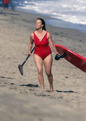 Alanis Morissette paddleboarding in red swimsuit -17