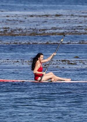 Alanis Morissette paddleboarding in red swimsuit -18
