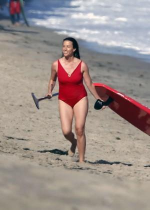Alanis Morissette paddleboarding in red swimsuit -20