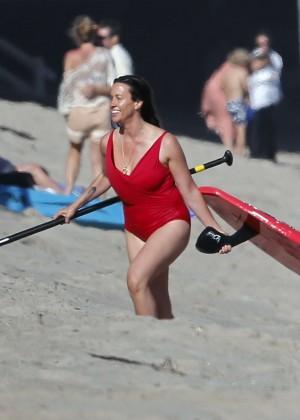 Alanis Morissette paddleboarding in red swimsuit -22