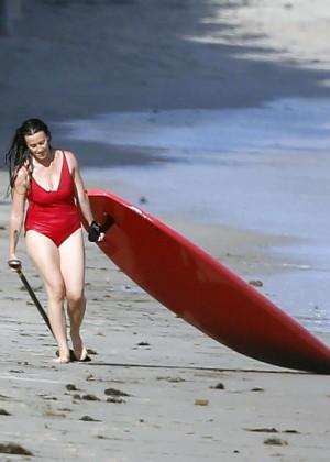 Alanis Morissette paddleboarding in red swimsuit -23