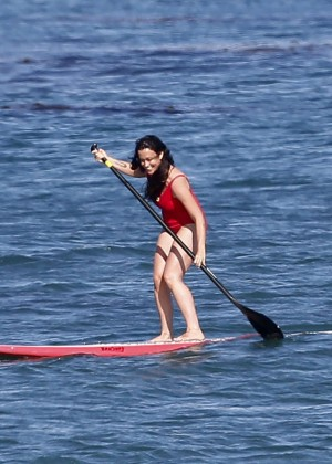 Alanis Morissette paddleboarding in red swimsuit -25