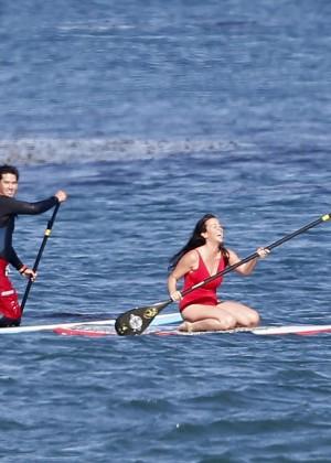 Alanis Morissette paddleboarding in red swimsuit -27