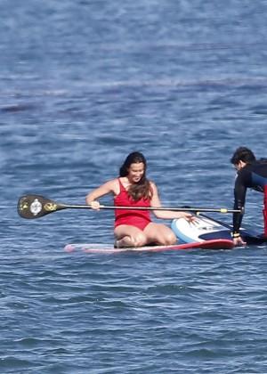 Alanis Morissette paddleboarding in red swimsuit -30