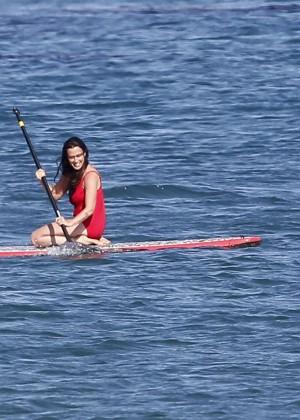 Alanis Morissette paddleboarding in red swimsuit -33