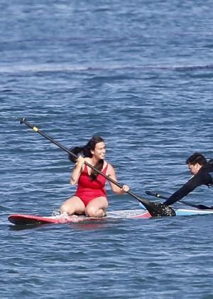 Alanis Morissette paddleboarding in red swimsuit -34