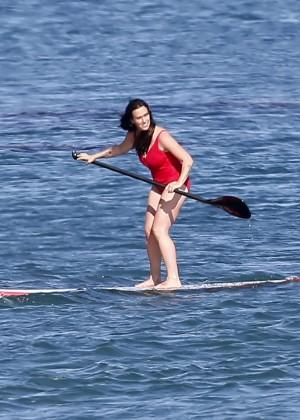Alanis Morissette paddleboarding in red swimsuit -35