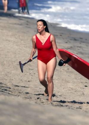 Alanis Morissette paddleboarding in red swimsuit -40