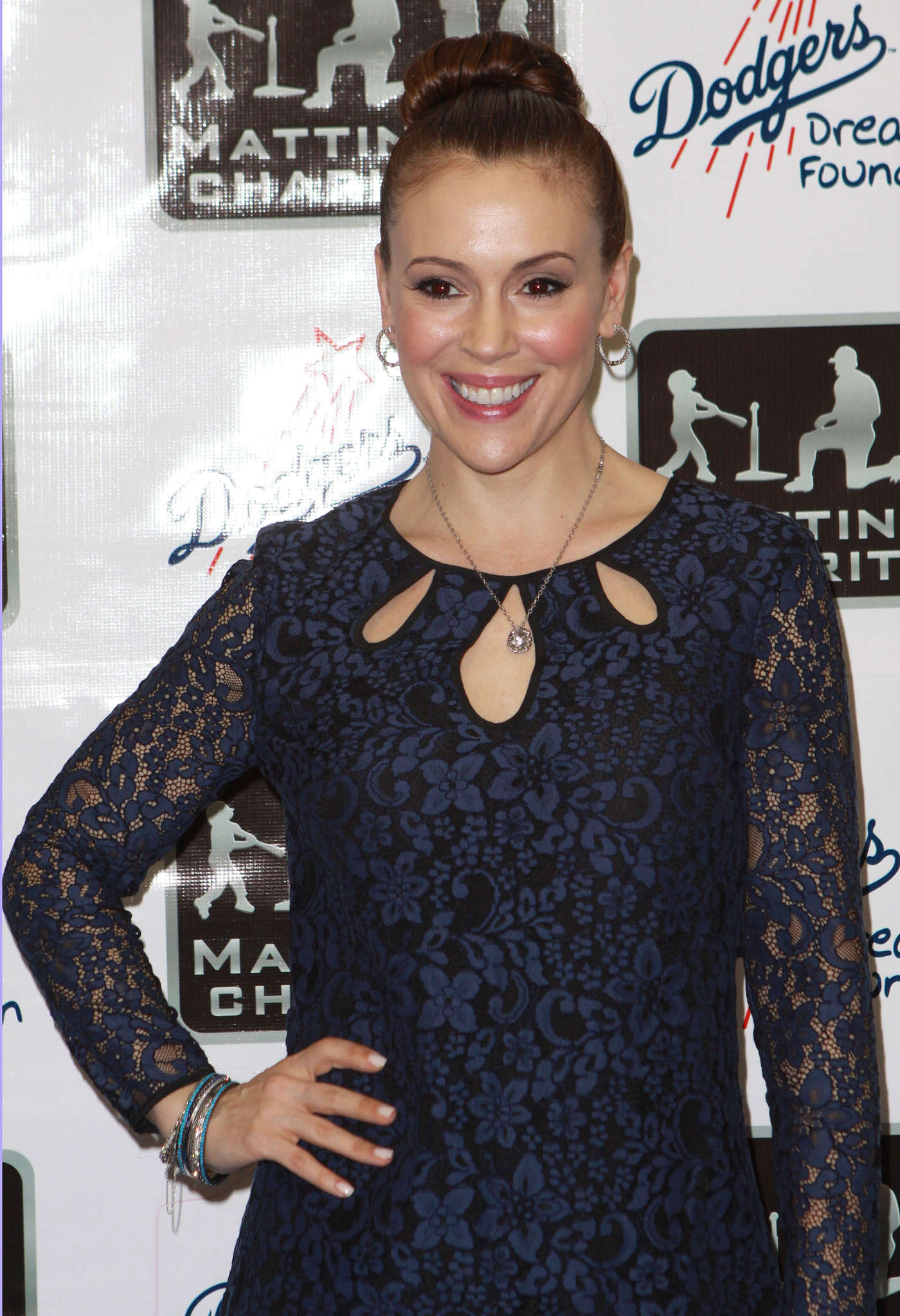 Alyssa Milano in short blue dress at A Night of Entertainment in Los Angeles, January 24, 2013