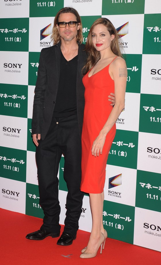Angelina Jolie – Red Dress Candids at Moneyball Premiere in Tokyo-01