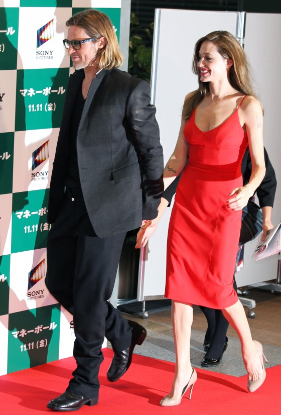 Angelina Jolie – Red Dress Candids at Moneyball Premiere in Tokyo-06