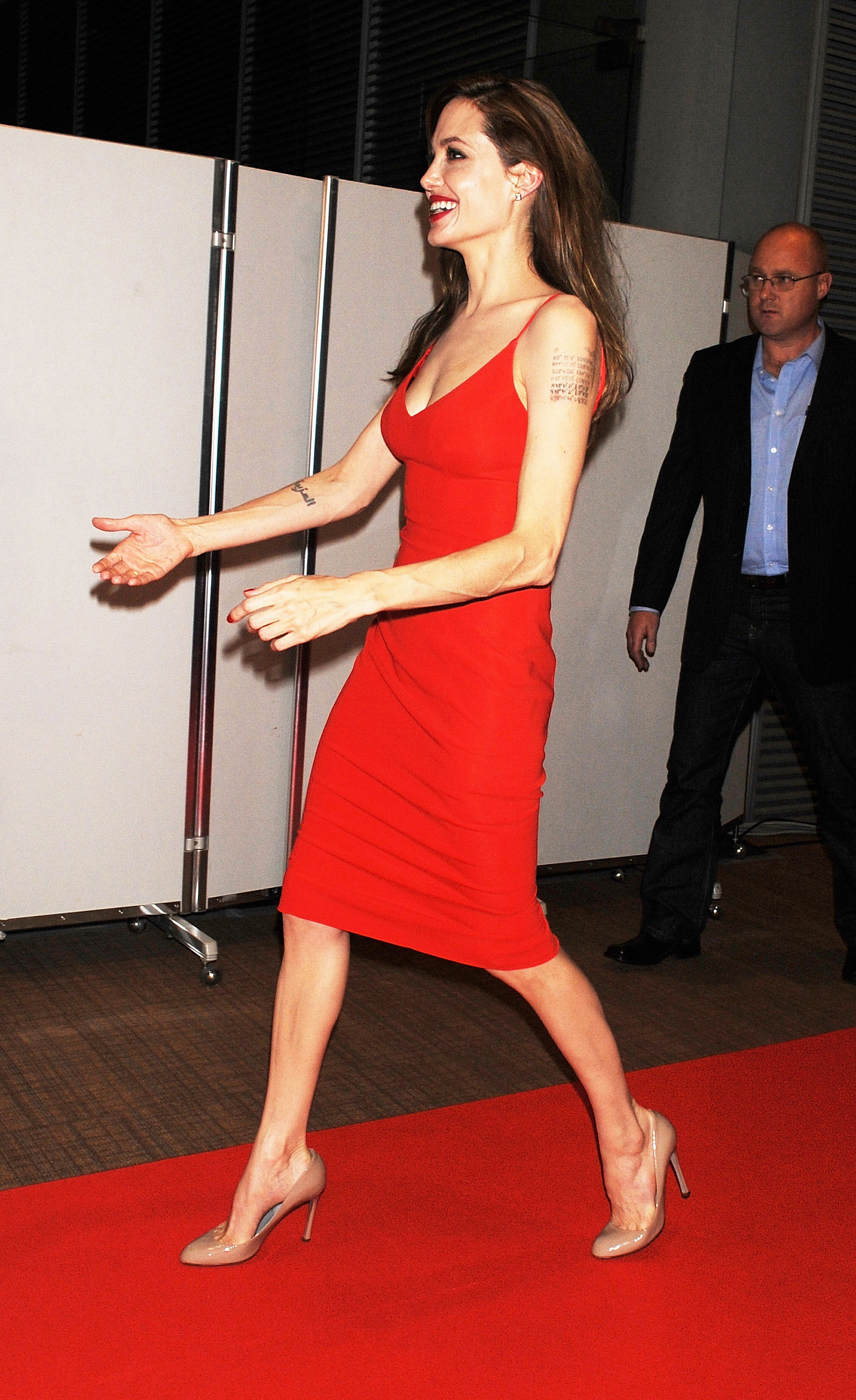 Angelina Jolie Red Dress Candids At Moneyball Premiere
