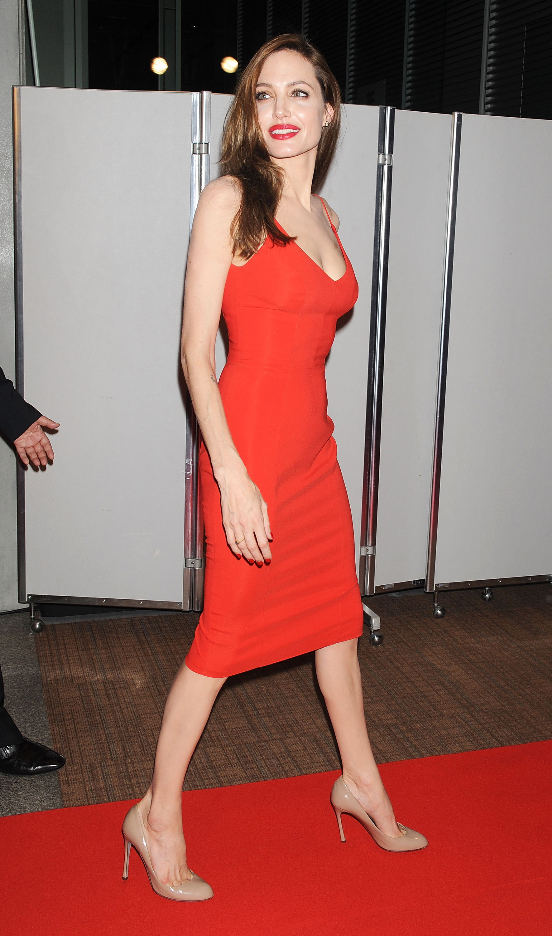 Angelina Jolie - Red Dress Candids at Moneyball Premiere in Tokyo ...