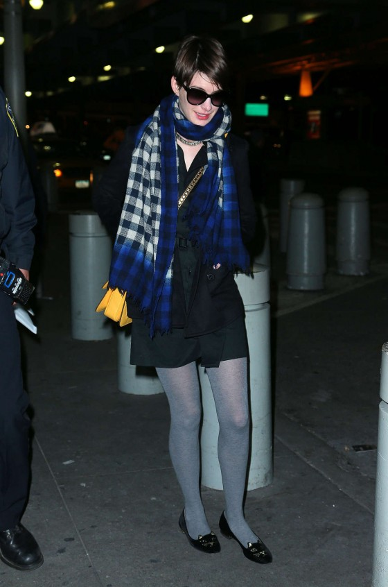 Anne Hathaway wearing glasses at JFK Airport in NYC