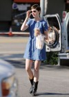Anne Hathaway in blue mini dress Picking Up Drinks At Earth Bar In West Hollywood