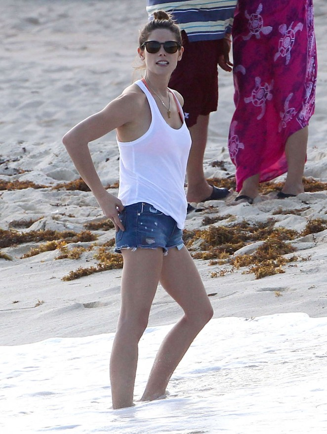 Ashley Greene in Denim Shors on the beach in Cancun