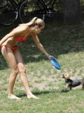 ashley-hart-and-jessica-hart-playing-frisbee-in-a-bikini-03