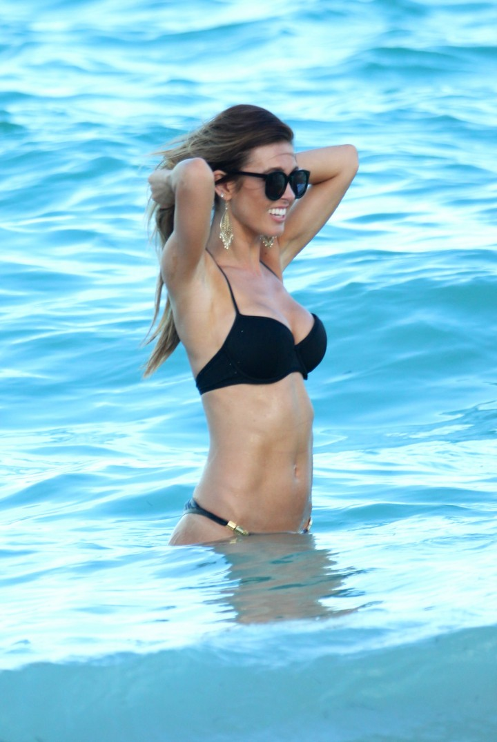 Audrina Patridge - Wearing black bikini at a beach in Miami