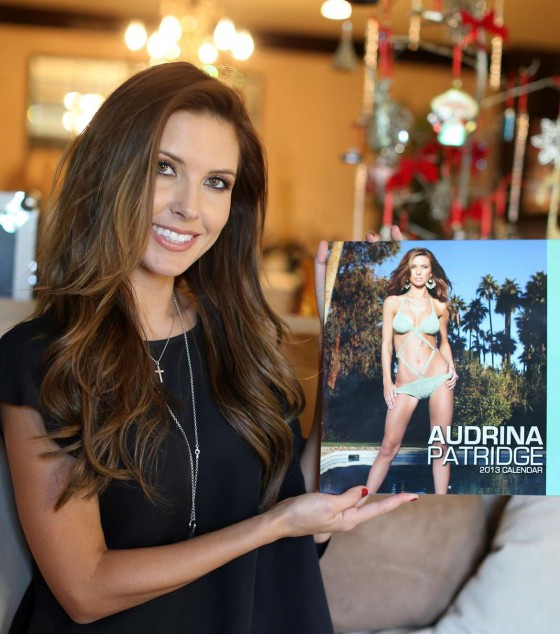 Audrina Patridge Possing with her new 2013 calendar