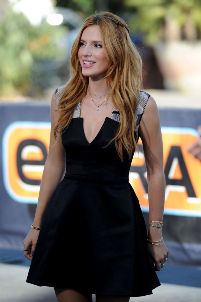 Bella Thorne in Black Mini Dress on the set of Extra in Universal City