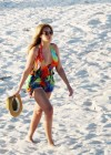 Beyonce knowles show nice legs on a beach in the Caribbean.