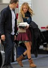 Blake Lively showing legs in a short skirt on the set of Gossip Girl