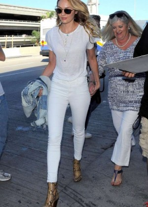 Candice Swanepoel in White Jeans at LAX in LA