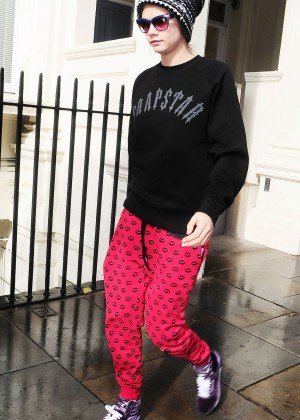 Cara Delevingne in Red Sweats Leaving her house in London
