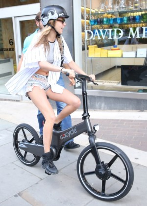 Cara Delevingne in Short Shorts Riding a Bicycle in London
