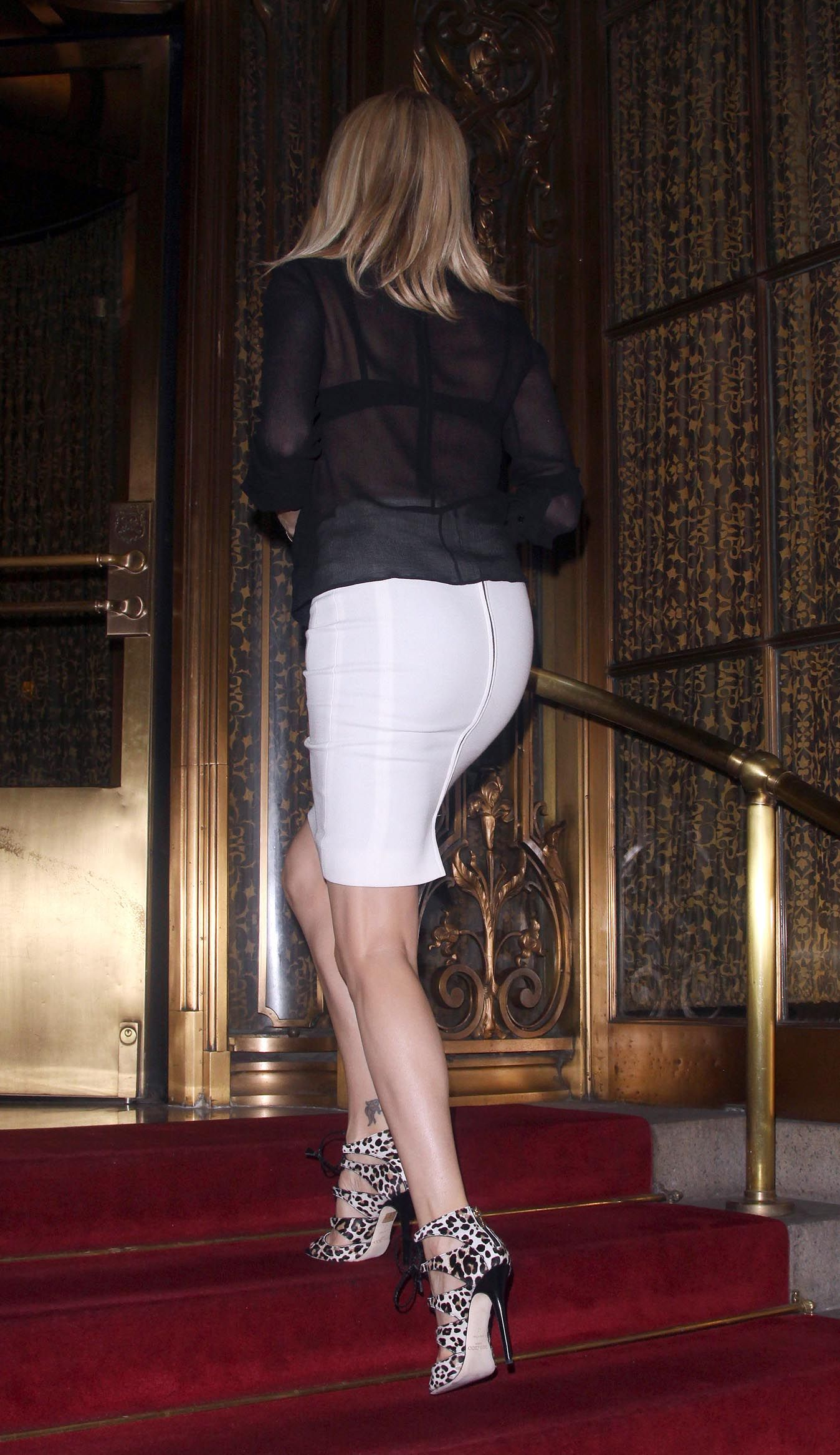 charlize theron and in a tight skirt and high