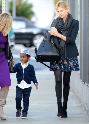 Charlize Theron in Mini Drees Out in Los Angeles