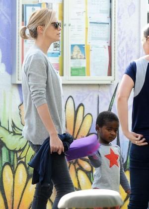 Charlize Theron in Black Leggings -13
